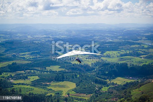 Hang glider flying in the brazilian mountains.