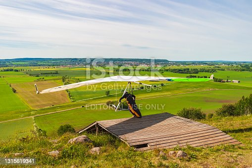 Falköping, Sweden - June 13, 2015: Hang glider start at a ramp on a hill in a beautiful country landscape