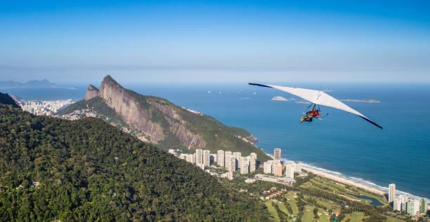 Hang gliding off Pedra Bonita is a popular thrill-seeking activity. Overlooking Rio de Janeiro, Brazi stock photo
