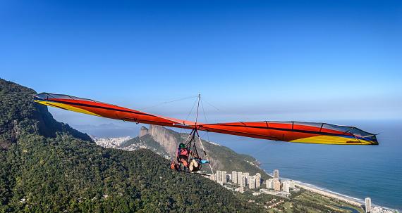 Hang Gliding Off Pedra Bonita Is A Popular Thrillseeking Activity  Overlooking Rio De Janeiro Brazi Stock Photo - Download Image Now