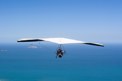 Hang Gliding Over Ocean Sports Stock Photo - Download Image Now