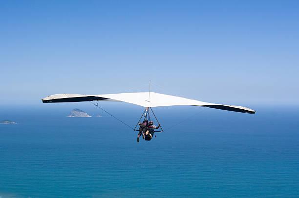 Hang Gliding Over Ocean. Sports. stock photo
