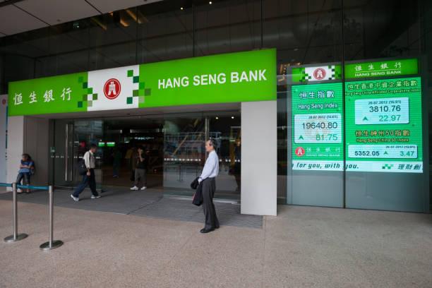 hang seng bank in hong kong - hang seng index stock-fotos und bilder