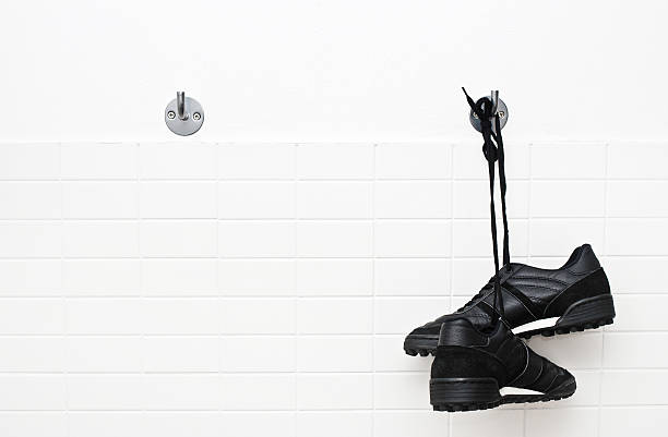 Hang up soccer shoes Hang up soccer shoes studded stock pictures, royalty-free photos & images
