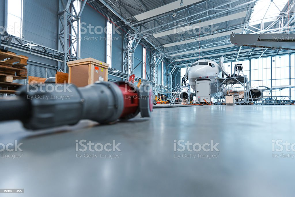 Hangar, low angle view Low angle view of hangar, aircraft in the background. Air Vehicle Stock Photo