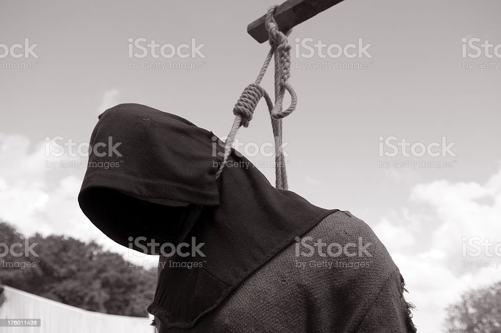 Hanged by the neck. Sepia toned. stock photo