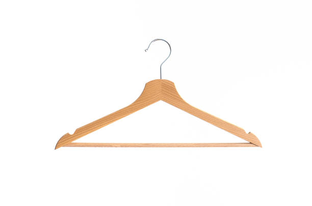 Hanger isolated Wooden coat hanger isolated against bright white background coathanger stock pictures, royalty-free photos & images