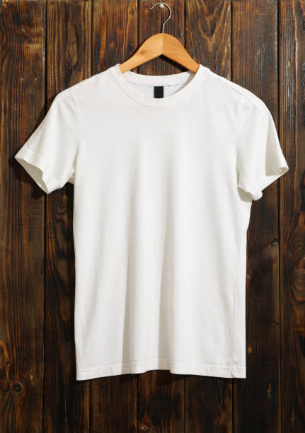 Hanger with blank white t-shirt on wooden background, space for text Hanger with blank white t-shirt on wooden background, space for text white t shirt stock pictures, royalty-free photos & images