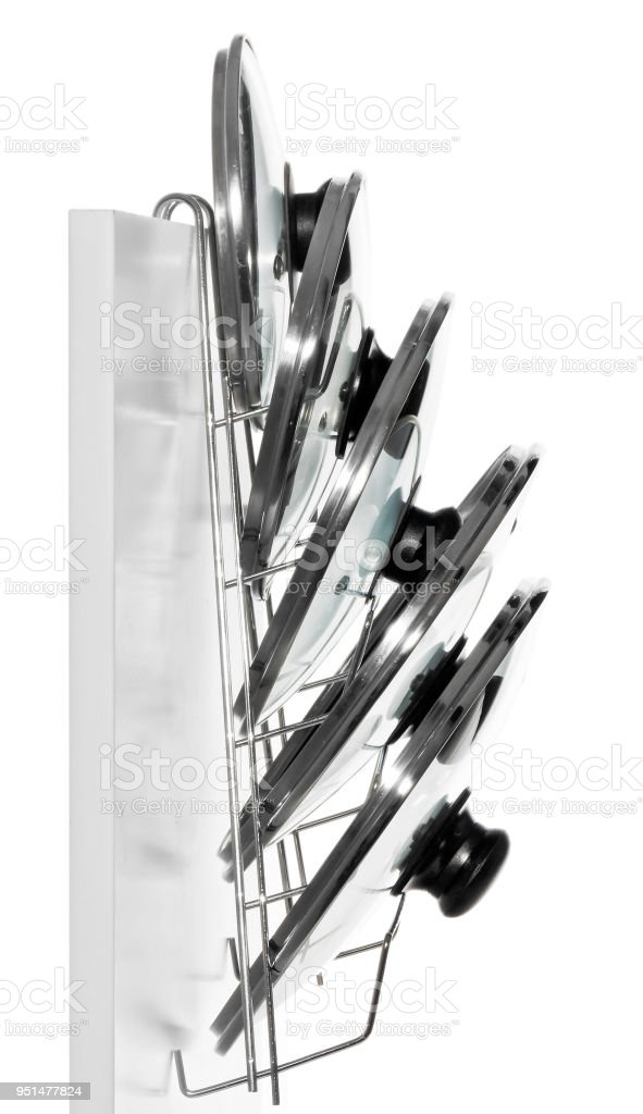 A Hanger With Glass Lids For Cooking Pots Hung On The Door Of A Kitchen Cupboard Stock Photo Download Image Now Istock