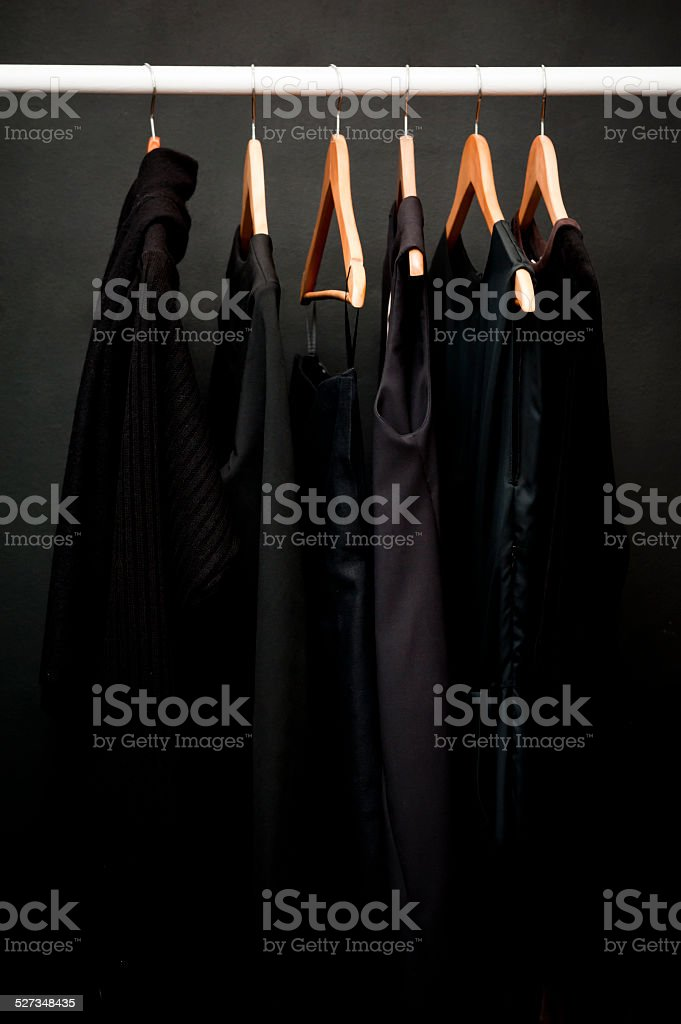Hangers, black clothes (Click for more) stock photo