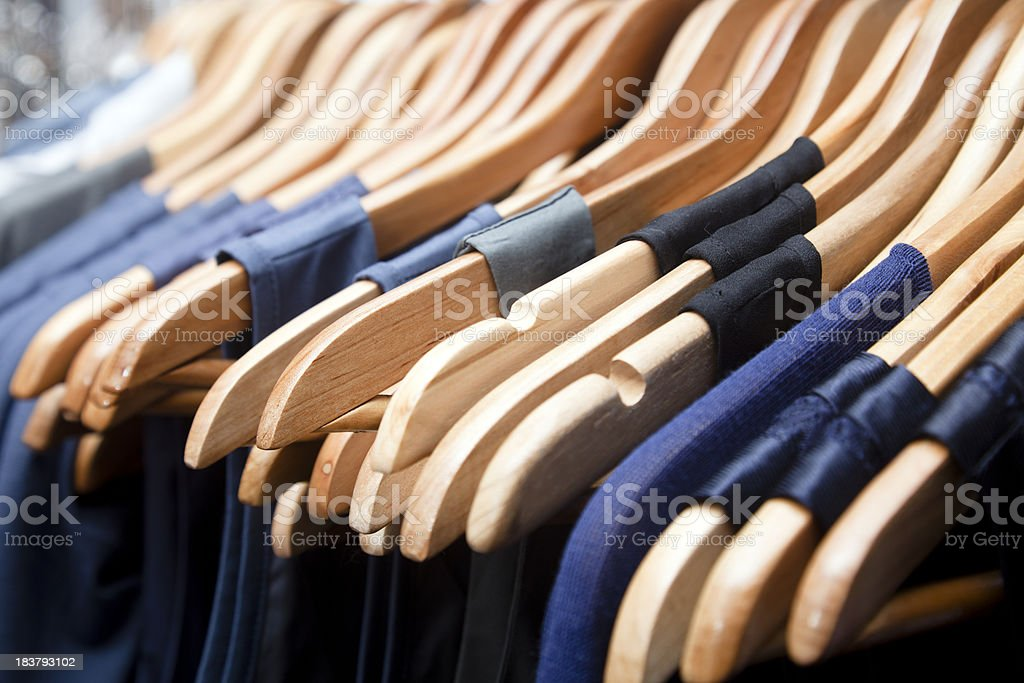 Hangers, blue dresses stock photo