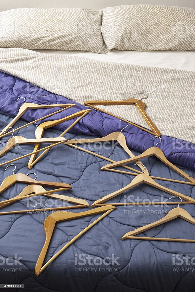 Hangers over bed royalty-free stock photo