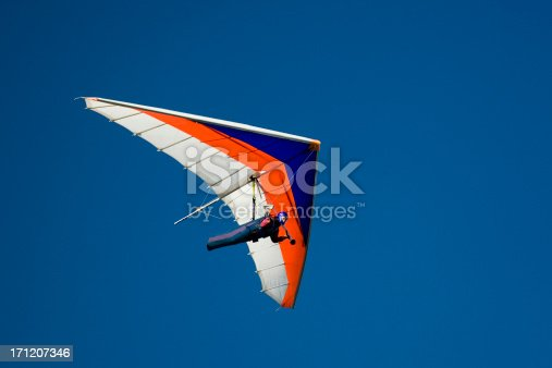 Hang-glider shot against a blue sky
