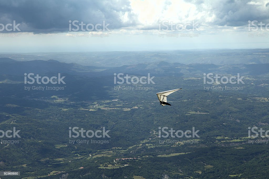 Hangglider under clouds royalty-free stock photo