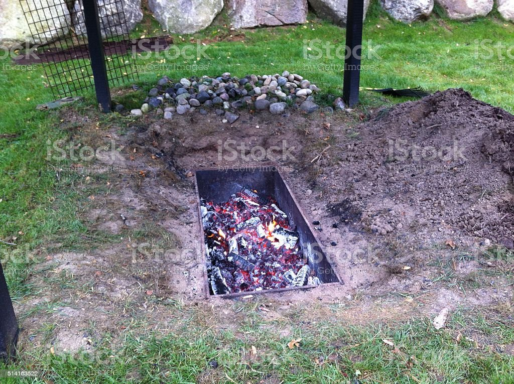 Hangi Maori food cooked in underground oven Celebration Stock Photo