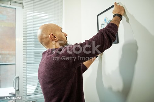 istock Hanging a picture frame 1170193085
