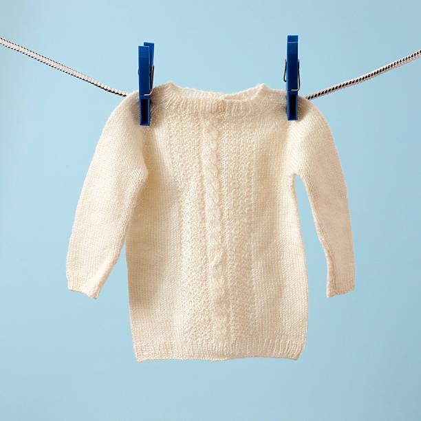 Hanging baby sweater stock photo