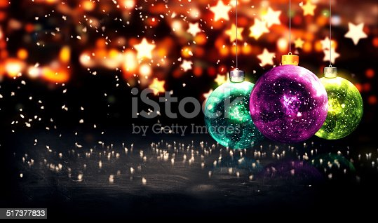 505891566istockphoto Hanging Baubles Christmas Yellow Star Night Bokeh Beautiful 3D 517377833
