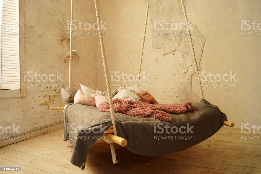 hanging bed in rural or loft bedroom interior gm