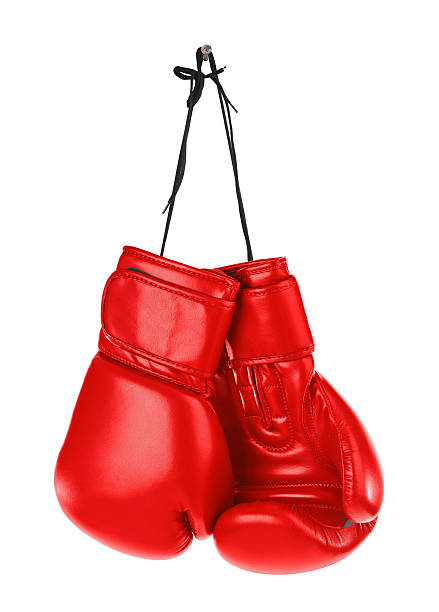 Hanging boxing gloves stock photo