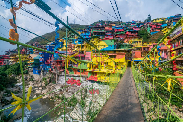 hanging bridge connecting to stobosa mural a valley of colors in la trinidad, benguet, baguio city - baguio city stock photos and pictures