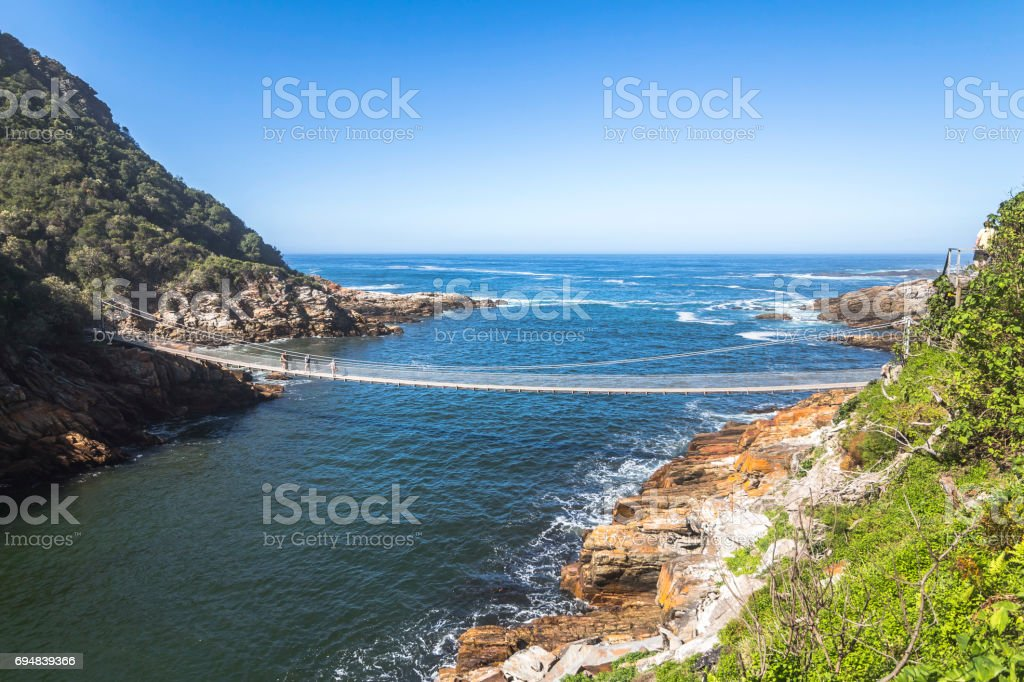 Hanging bridge over Storms River mouth, Tsitsikamma National Park stock photo