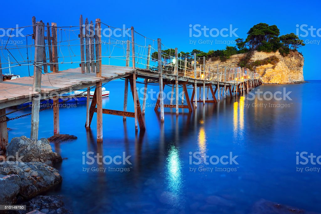 Hanging bridge to the island at night stock photo