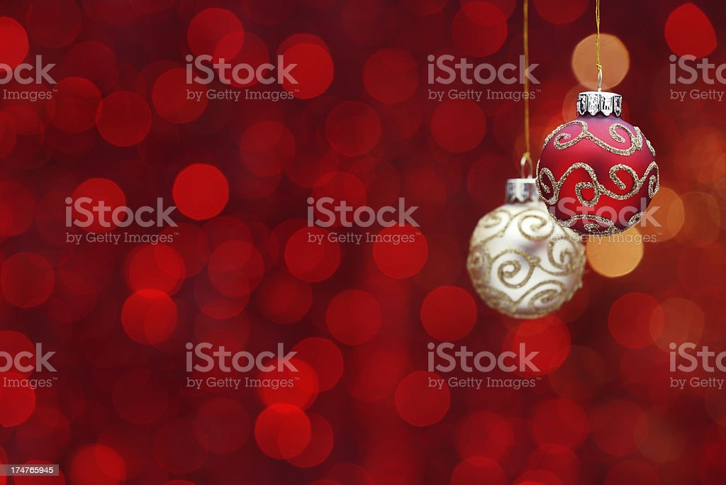 Hanging christmas balls on red illuminated background royalty-free stock photo