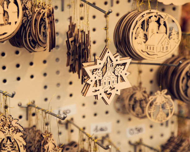 Hanging Christmas tree hand carved wooden decorations in market stall Hanging Christmas tree hand carved wooden decorations in market stall carving craft product stock pictures, royalty-free photos & images