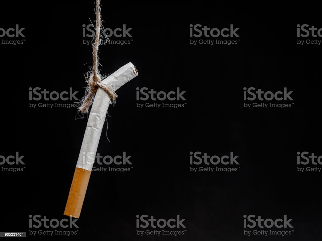 hanging cigarete on black background. kill yourself.  Quitting smoking concept. world no tobacco day zbiór zdjęć royalty-free