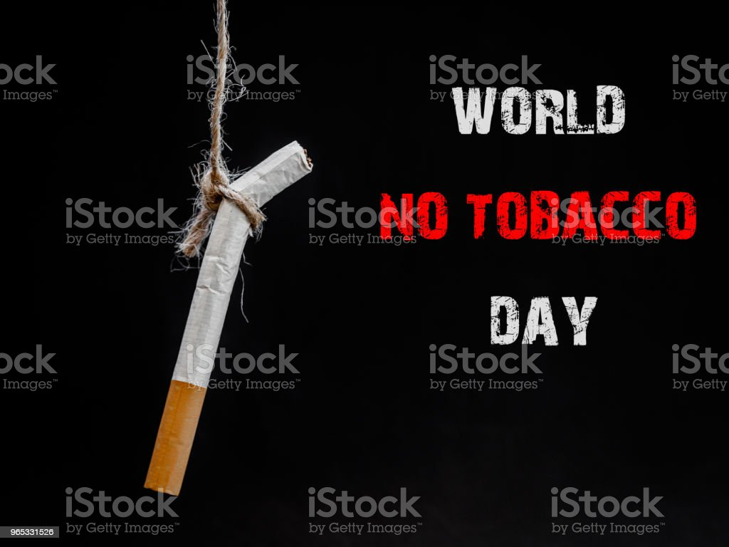 hanging cigarete on black background. kill yourself.  Quitting smoking concept. world no tobacco day royalty-free stock photo
