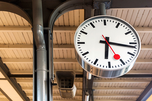 Hanging clock at railway station in Geneva, Switzerland