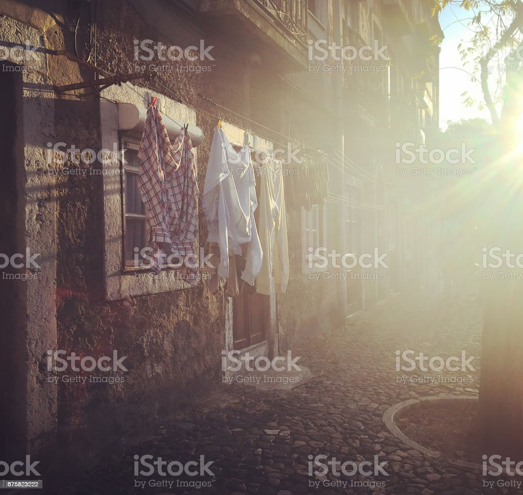 Hanging clothes in the street, for drying in old Europe city, Typical...