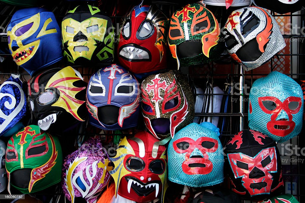 Hanging colorful Mexican Lucha Libre wrestling masks stock photo