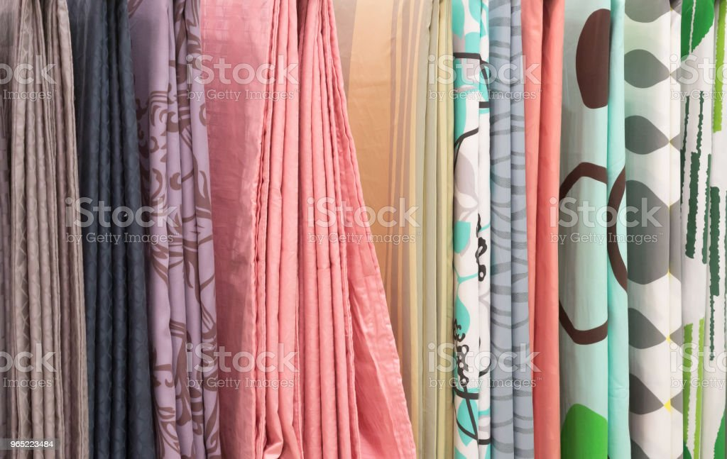 Hanging colorful sheet for covering bed zbiór zdjęć royalty-free