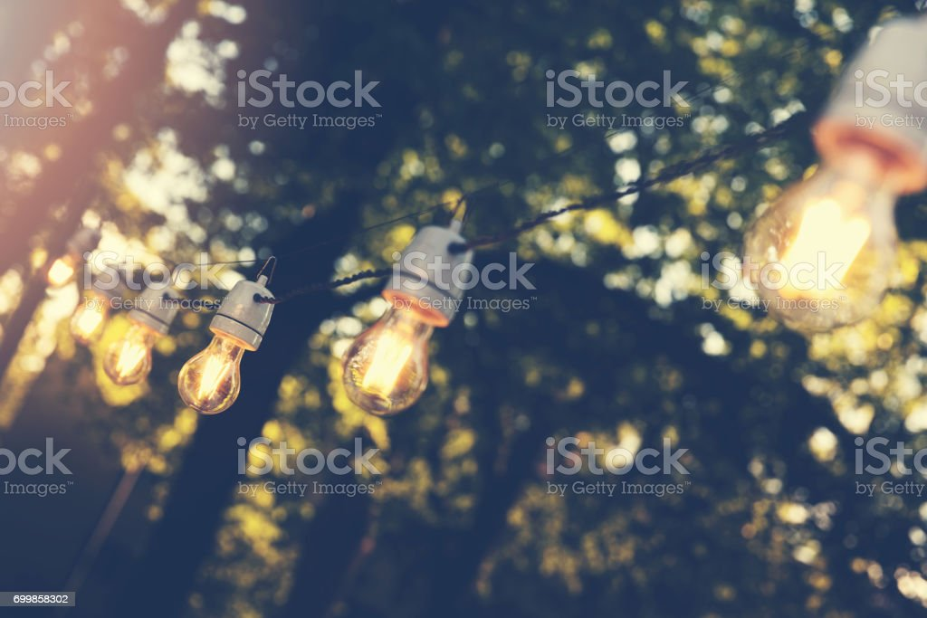 hanging decorative string lights for outdoor party stock photo