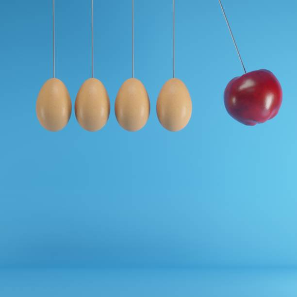 Hanging eggs with Red Apple different idea on blue background , Minimal concept idea stock photo