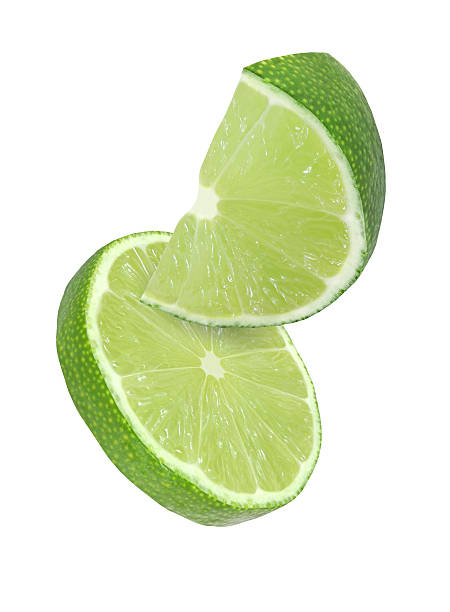 hanging, falling, flying lime fruits isolated with clipping path stock photo