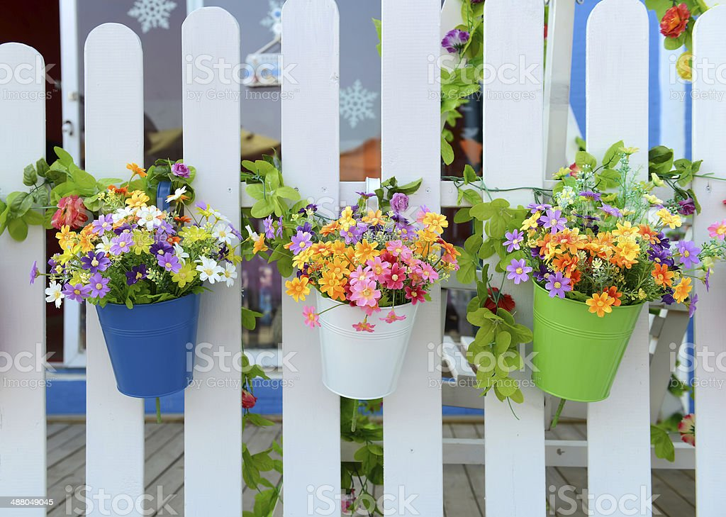 Hanging Flower Pots with fence stock photo