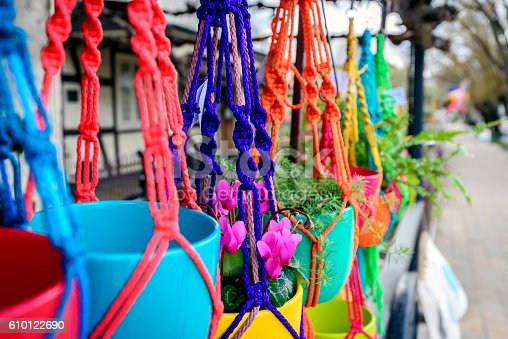 istock Hanging flowers in colorful pots 610122690