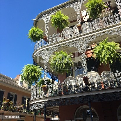 Potted plants hang from the balconies of the French Quarter in New Orleans