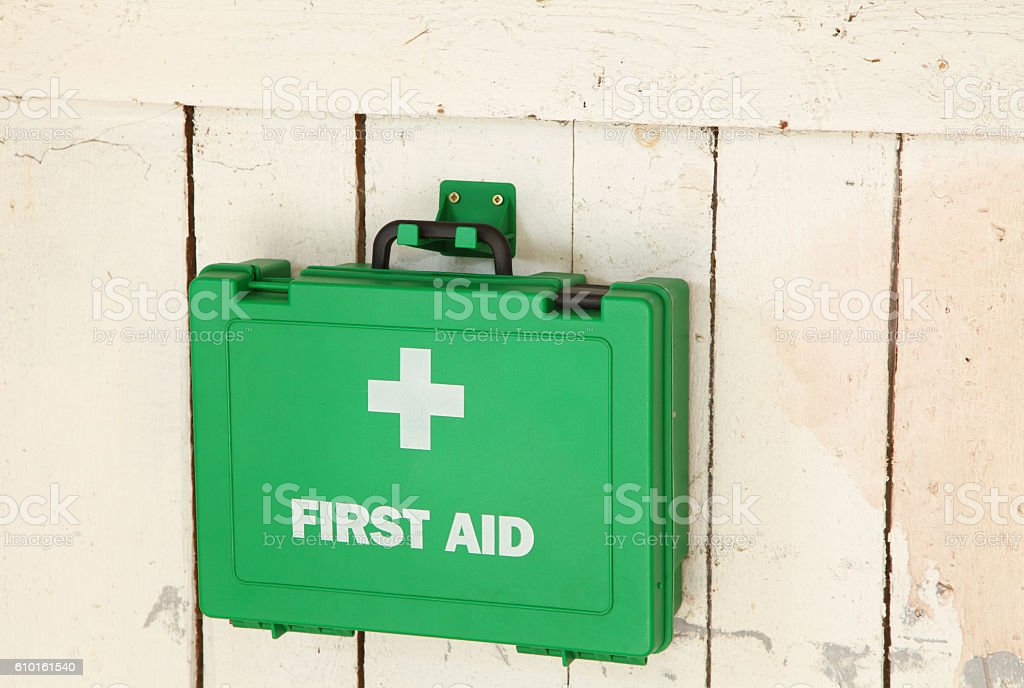 hanging green first aid kit in workshop stock photo