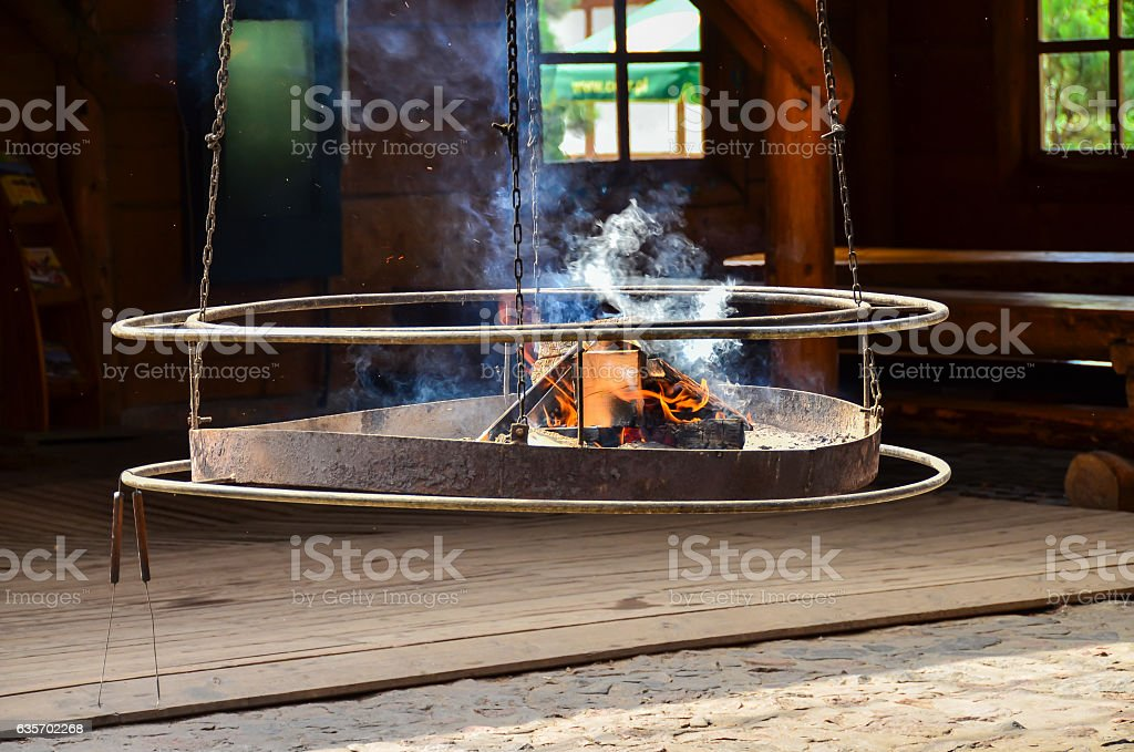 Hanging grill with fire royalty-free stock photo