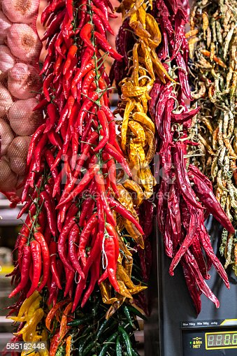 Hanging hot chilli peppers and garlic in farmer's market
