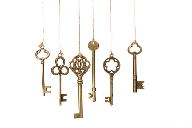 Hanging Keys Hanging old Keys on white background. medium group of objects stock pictures, royalty-free photos & images