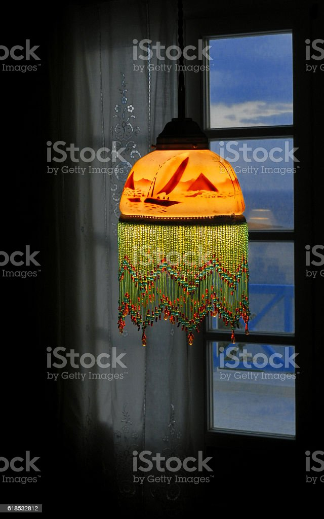 Hanging lamp in front the window. stock photo