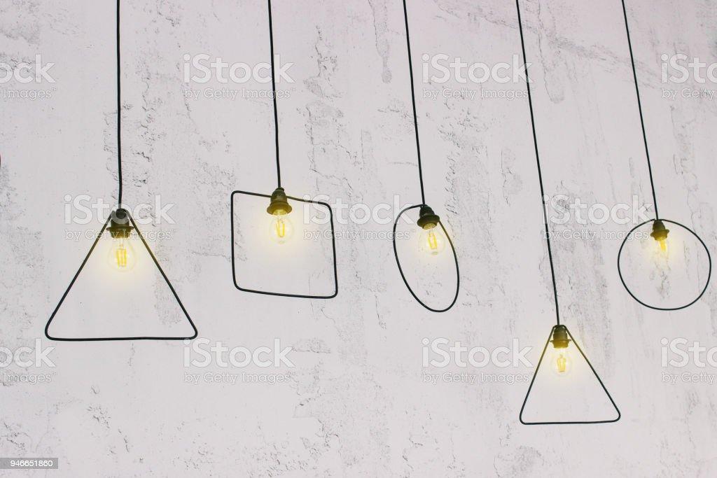Hanging Light Bulb. Original light bulbs near the wall