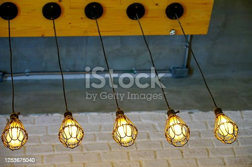 1137999886 istock photo Hanging Light Bulbs 1253675040
