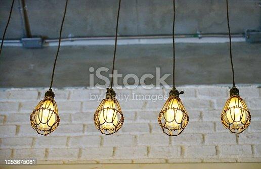 1137999886 istock photo Hanging Light Bulbs 1253675081