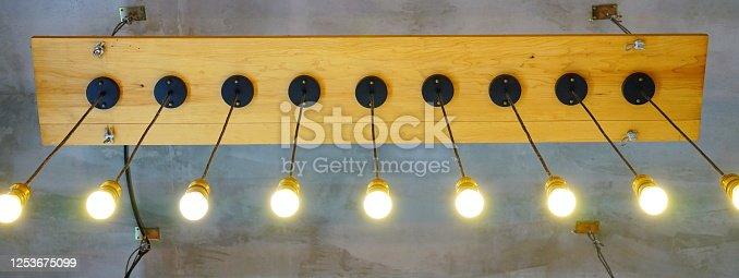 1137999886 istock photo Hanging Light Bulbs 1253675099